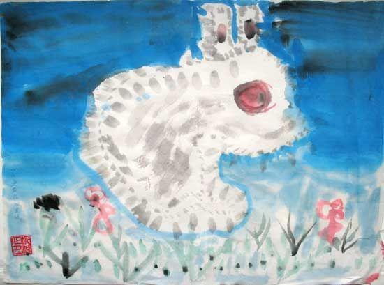 侧面的小白兔,大大的红眼睛,两只竖起的长耳朵,白色的毛.